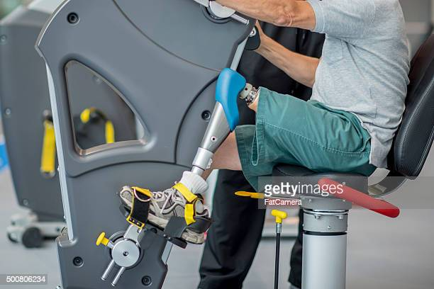 Man with a Prosthetic Leg Exercising at the Gym