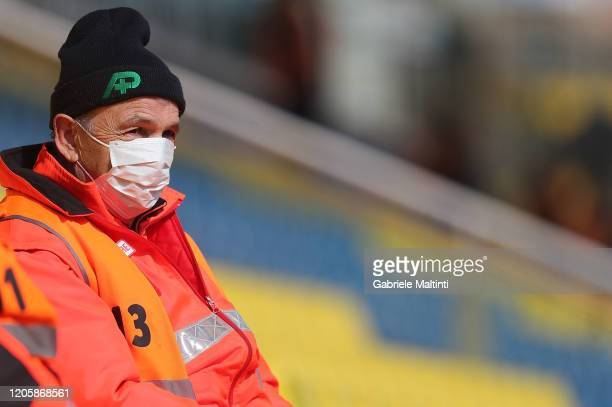 A man with a protective mask during the Serie A match between Parma Calcio and SPAL at Stadio Ennio Tardini on March 1 2020 in Parma Italy