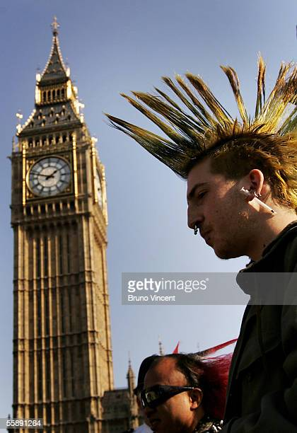 A man with a punk style hair cut and a syringe earring walks past St Stevens Tower commonly known as Big Ben October 10 2005 in London