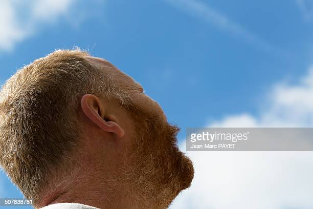 man with a red beard looking at the sky - jean marc payet stock pictures, royalty-free photos & images