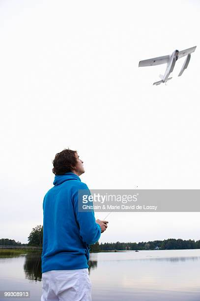 man with a remote-controlled plane - remote controlled stock photos and pictures