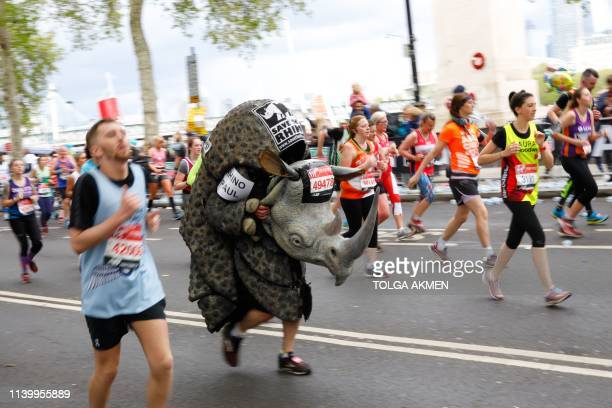 A man with a Rhinothemed costume runs as he competes in the 2019 London Marathon in central London on April 28 2019 / Restricted to editorial use...