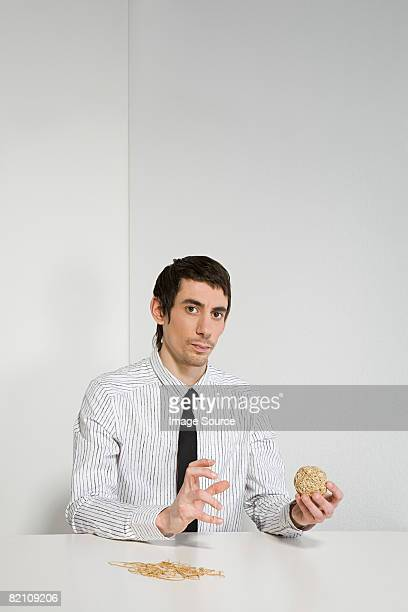 Man with a rubber band ball
