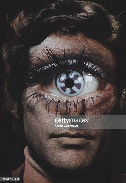 A man with a single large eye with an oddlyshaped iris circa 1985