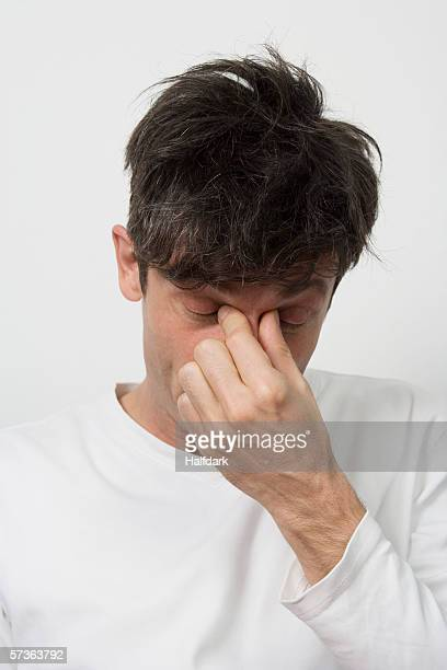A man with a sinus headache