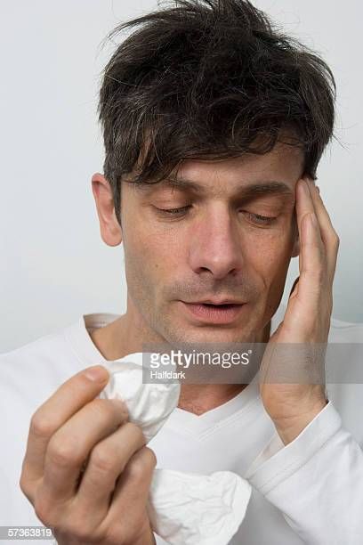 A man with a sinus headache