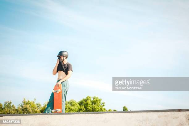 man with a skateboard - yusuke nishizawa stock pictures, royalty-free photos & images