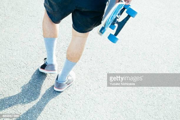 man with a skateboard - yusuke nishizawa stock-fotos und bilder