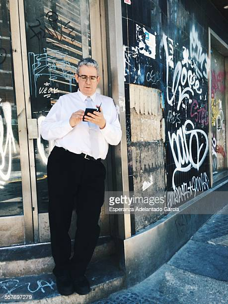 Man with a smartphone on the street Valencia Spain May 20 2015