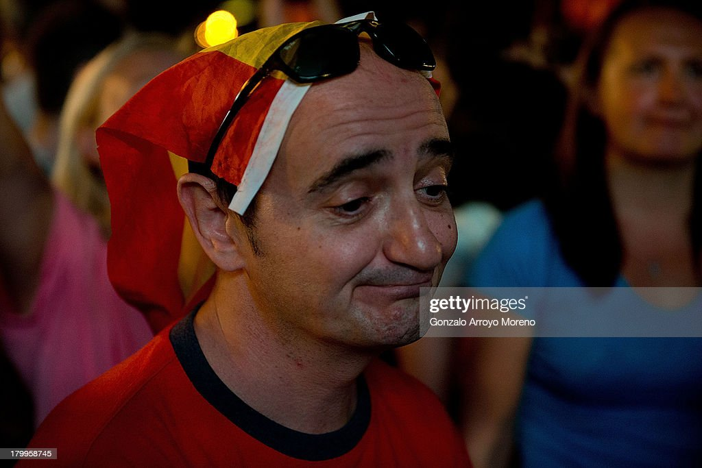 A man with a Spanish flag as a hat defeated after knowing the elimination of Madrid 2020 Candidancy at Puerta de Alcala on September 7, 2013 in Madrid, Spain.