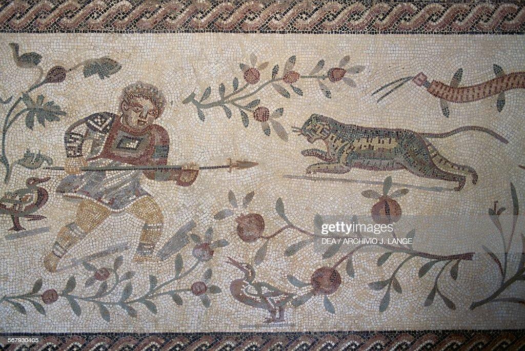 A man with a spear and a leopard, mosaic... : Nachrichtenfoto