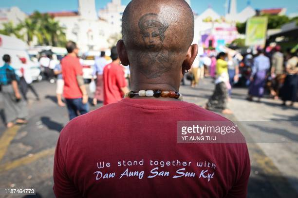TOPSHOT A man with a tattoo on the back of his head of the late general Aung San father of Myanmar's State Counsellor Aung San Suu Kyi attends a...