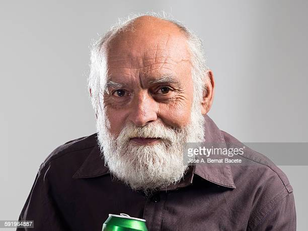 Man with a tin of beer in the hand