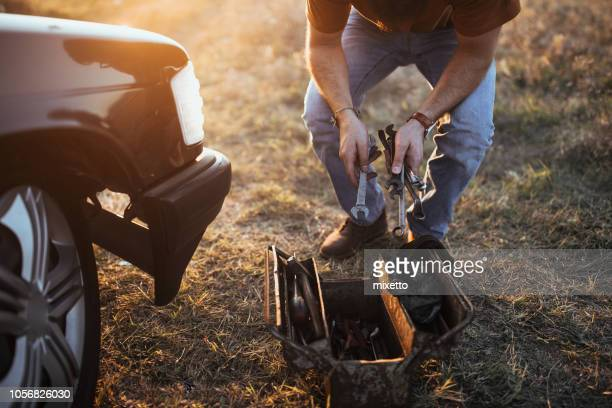 man with a tool in his hands - vintage auto repair stock pictures, royalty-free photos & images