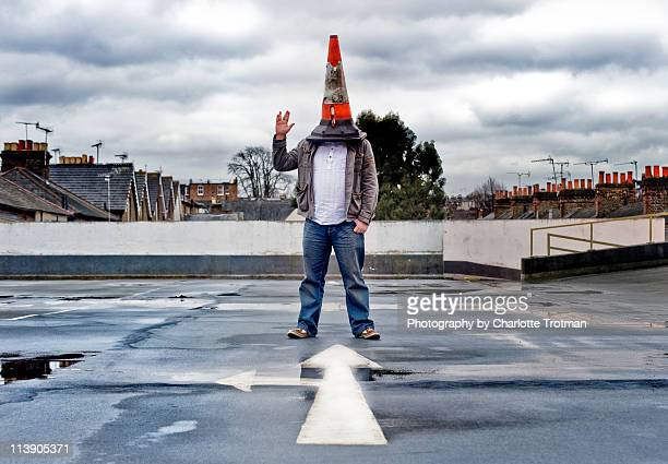 man with a traffic cone on his head - traffic cone stock pictures, royalty-free photos & images