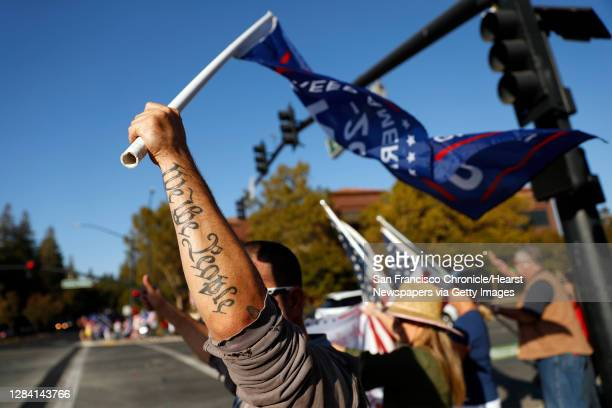 """Man with a """"We the People"""" tattoo joins other supporters of US president Donald Trump take part in a """"Trump Town USA Rally"""" at the intersection of..."""