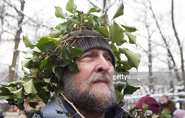 Man with a wreath of leaves on his head on the protest in defense of the Bialowieza Forest called quotMarch of the Entsquot in Warsaw 17 January...