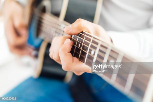 Man with acoustic guitar, close up