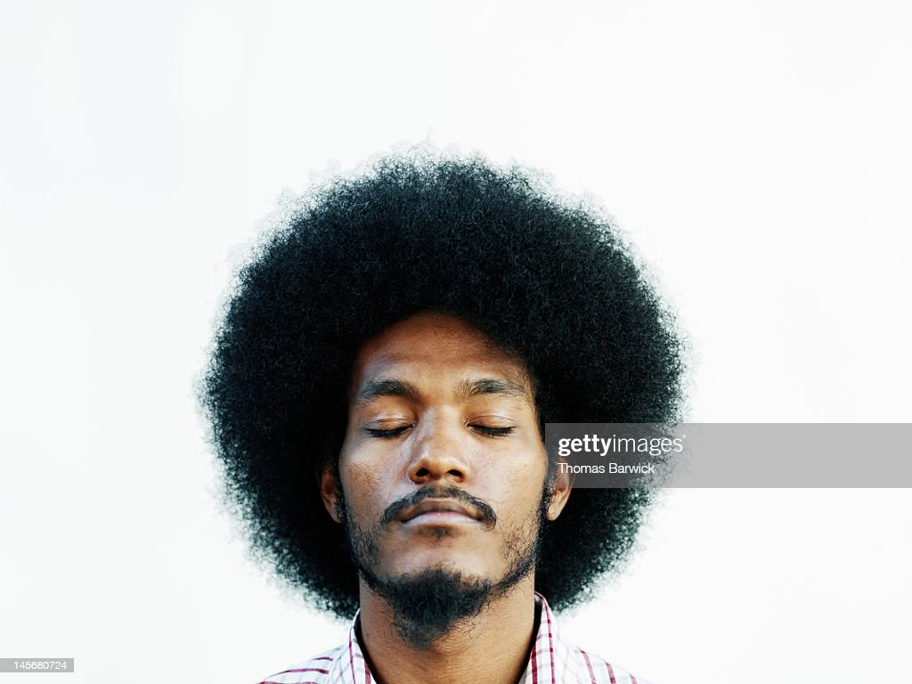 Man with afro hairstyle eyes closed chin up : Stock Photo