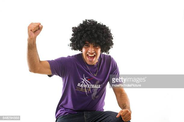 Man with an afro wig