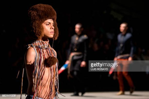 A man with an amputated arm models a creation by Colombian designer Guio Di Colombia during the Walkway Inclusion fashion show in Cali Colombia on...