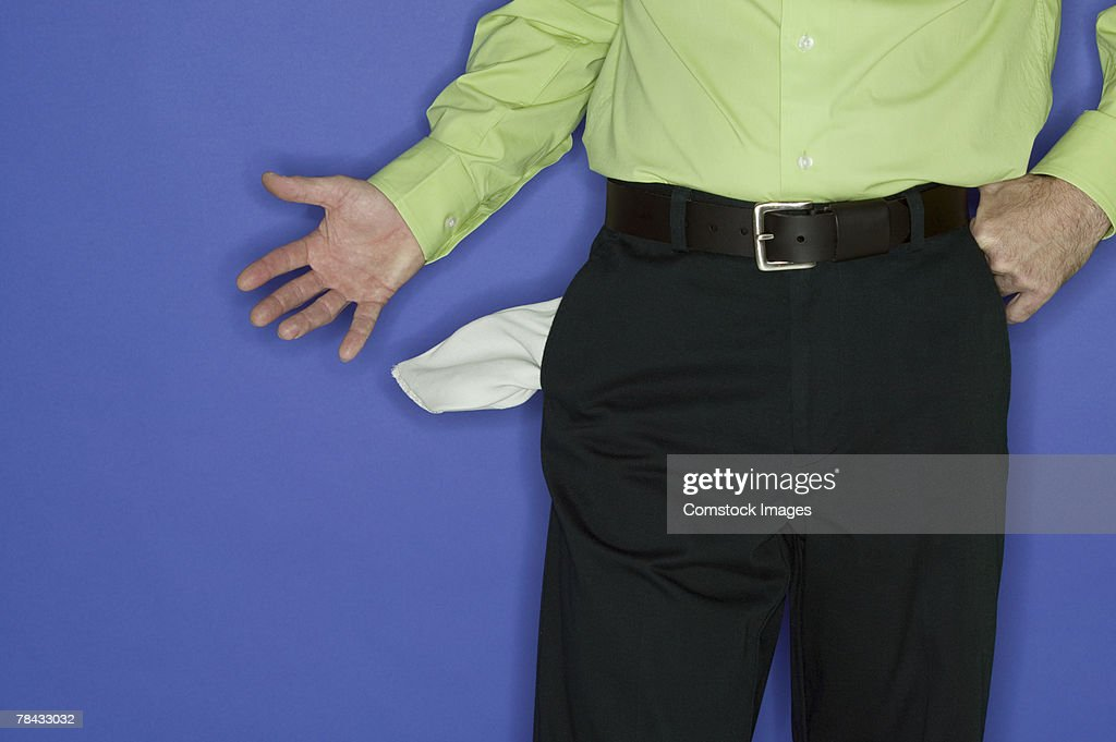 Man with an empty pockets : Stock Photo