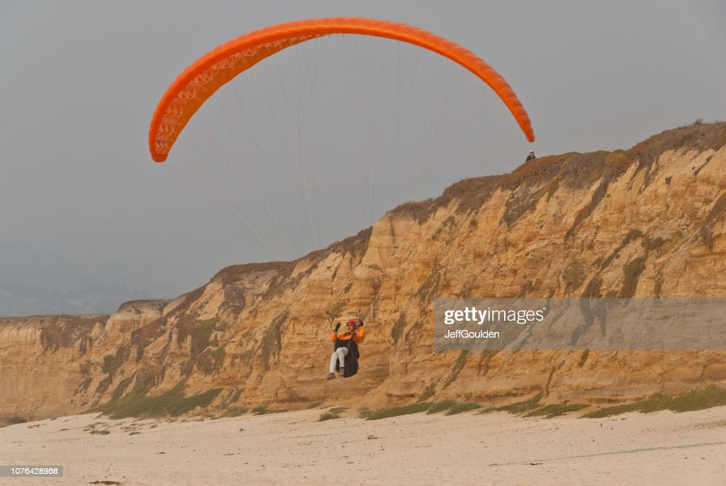 Paragliding Off a Bluff : Stock Photo