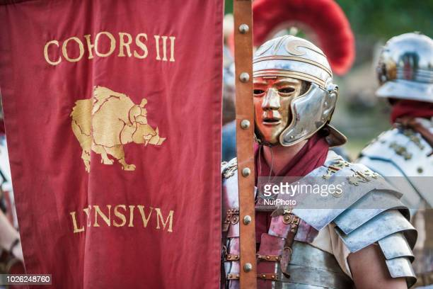 Man with ancient roman soldier costumes holds a flag during the celebrations of the recreation of the cantabrian wars in Los Corrales de Buelna Spain...