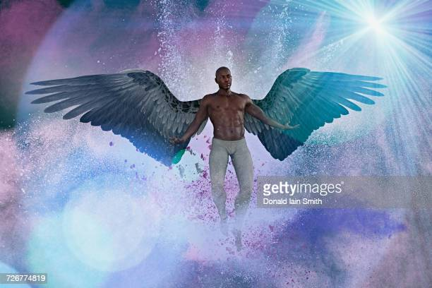 Man with angel wings flying in purple sky