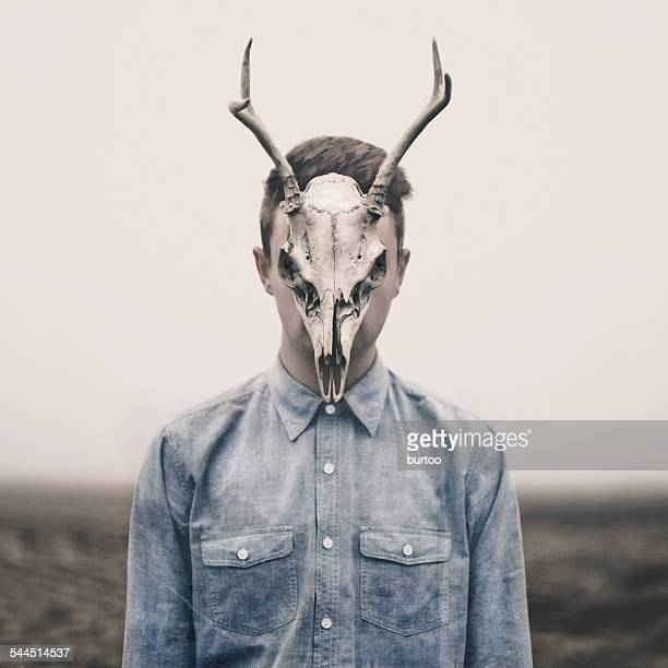 Man with animal skull on his face