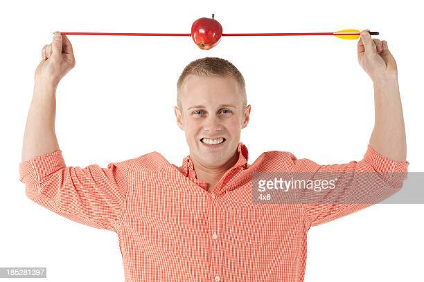 Man with apple and arrow on top of head
