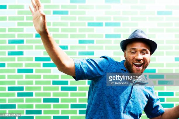 man with arm in air, dancing - hipster person stock pictures, royalty-free photos & images