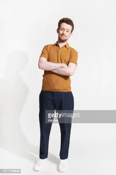 man with arms folded - one young man only stock pictures, royalty-free photos & images