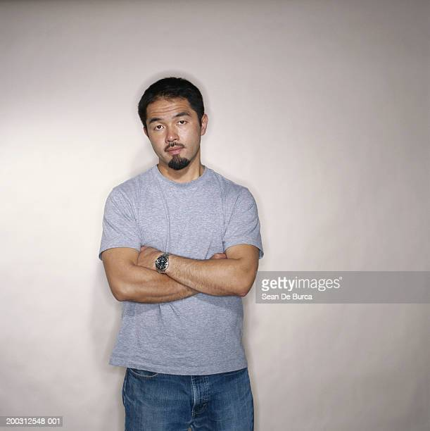 man with arms folded, portrait - goatee stock pictures, royalty-free photos & images