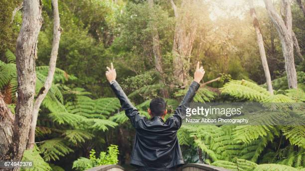 Man With Arms Outstretched After A Hike in Auckland, New Zealand.