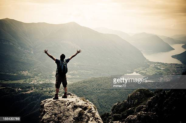Man with arms outstretched on mountaintop