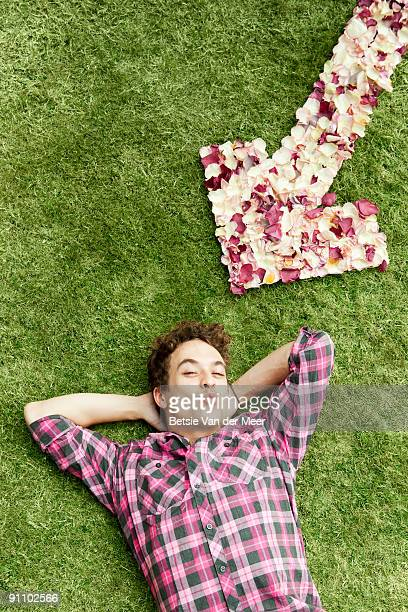 Man with arrow of rosepedals.