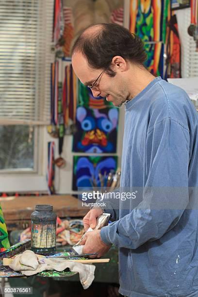 Man with aspergers preparing paint in his art studio