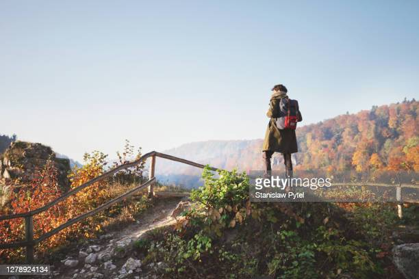 man with backpack looking at beautifull view in mountains at autumn - poland stock pictures, royalty-free photos & images