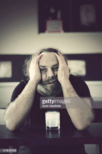 Man with bad hangover holding his head