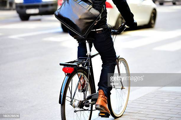 Man with bag on bicycle in motion