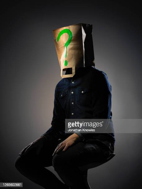man with bag on head - hiding stock pictures, royalty-free photos & images