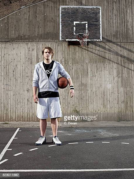 Man with ball standing on basketball ground