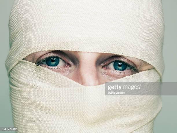 Man with bandaged face.