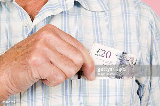 man with banknotes in his pocket - twenty pound note stock photos and pictures