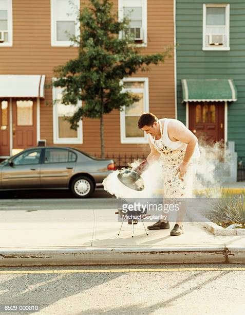 man with barbecue on street - funny bbq stock pictures, royalty-free photos & images