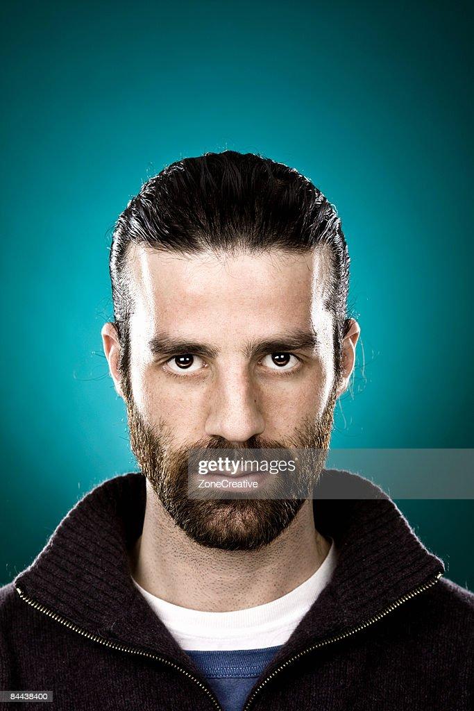 man with beard and black hair portrait : Stock Photo
