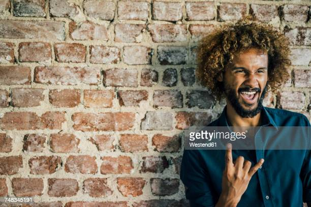 Man with beard and curly hair gesticulating