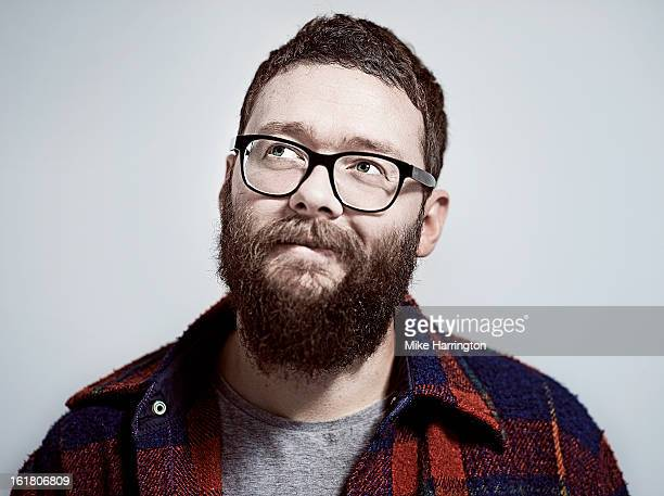 man with beard and glasses looking up to side - contemplation stock pictures, royalty-free photos & images