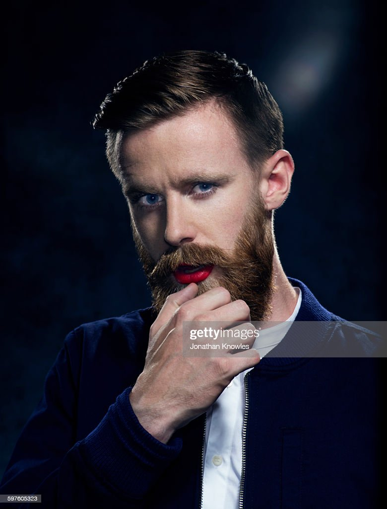 Man with beard and moustache in make up, posing : Stock Photo